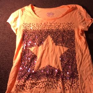 It is an orange tshirt with a pink and purple star